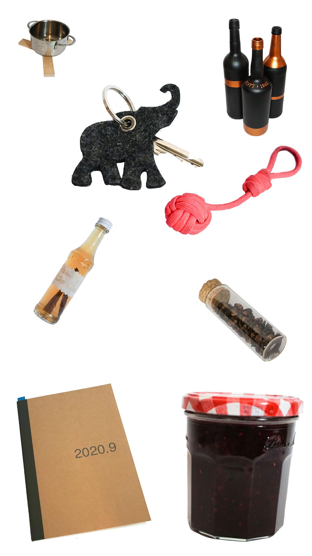 Verschiedene selbstgemachte Gegenstände auf weißem Hintergrund. Beispielsweise Schlüsselanhänger und Marmeladen.
